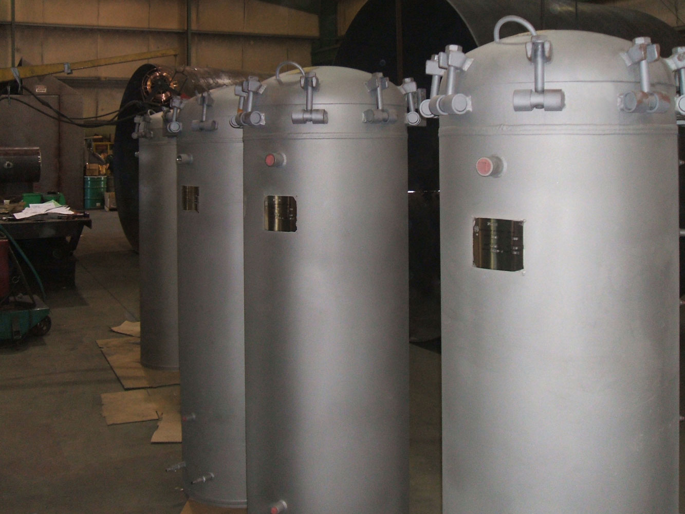 Pressure vessels with quick opening closures 3