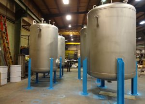 Stainless Steel Pressure Vessels with blue support legs